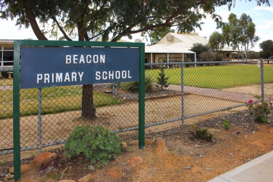 view from street of Beacon Primary School and sign