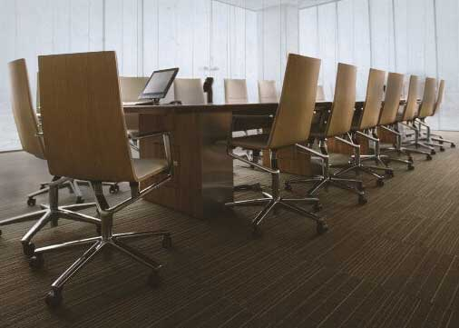 boardroom with large table surrounded by chairs