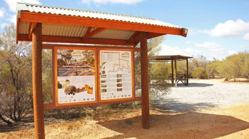Beacon Caravan Park welcome area with information panels