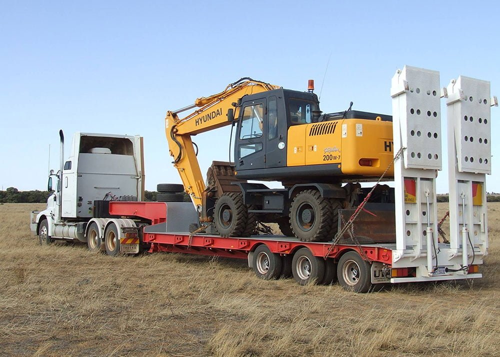 photo of heavy duty machinery on trailer