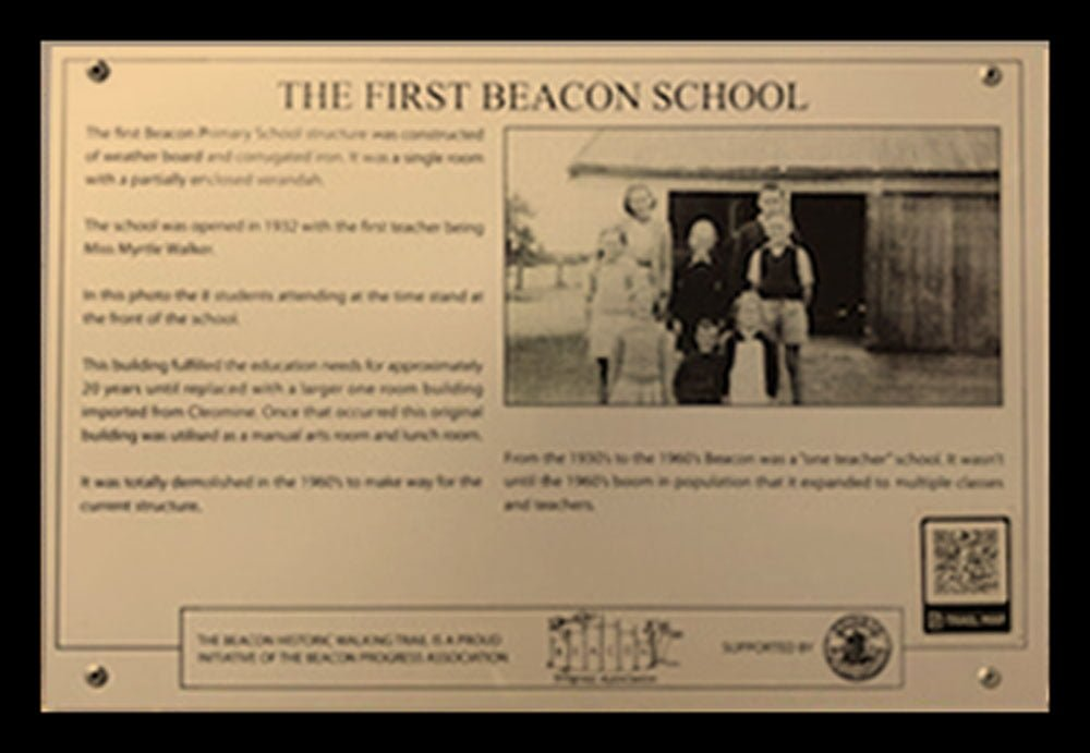 A Historic Walking Trail plaque of the first Beacon School