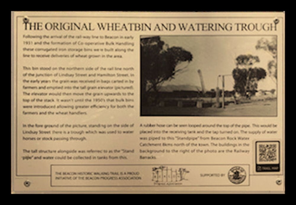 A Historic Walking Trail plaque of the original Beacon Wheat bin