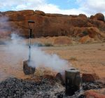 Billiburning fire with cooking pot and shovel