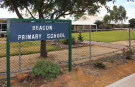 education - view from street of Beacon Primary School and sign